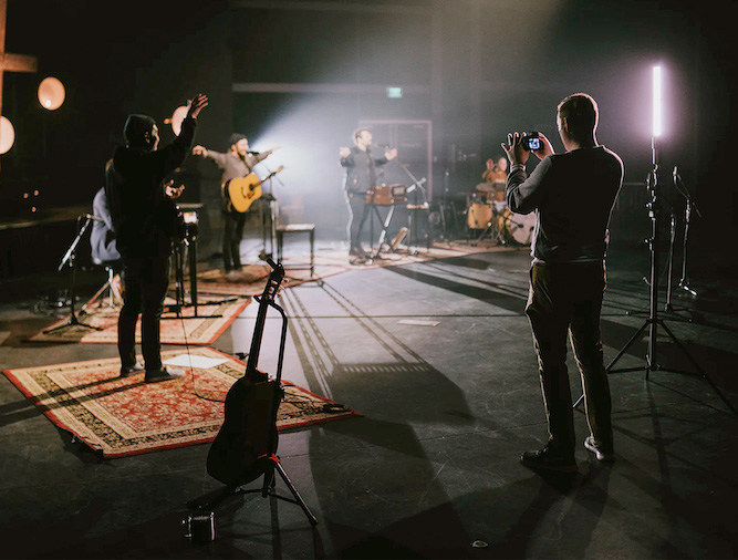 A background image of a band practicing