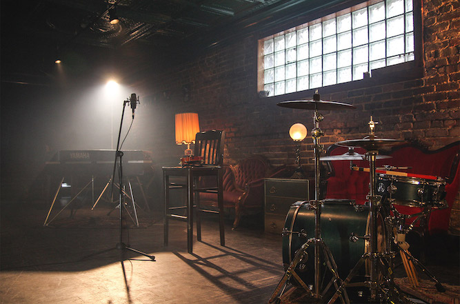 A background image of a band practice room